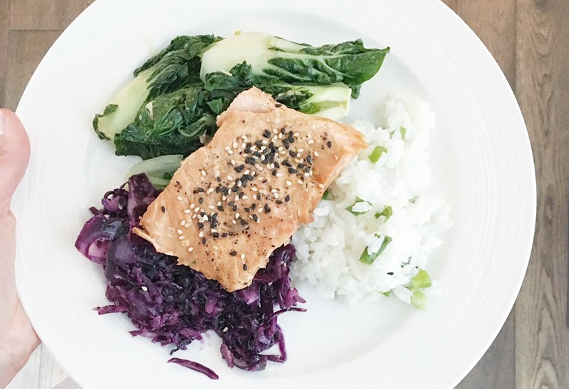 Plate with salmon, rice, bok choy and purple cabbage. Are fish and seafood safe to eat during pregnancy?